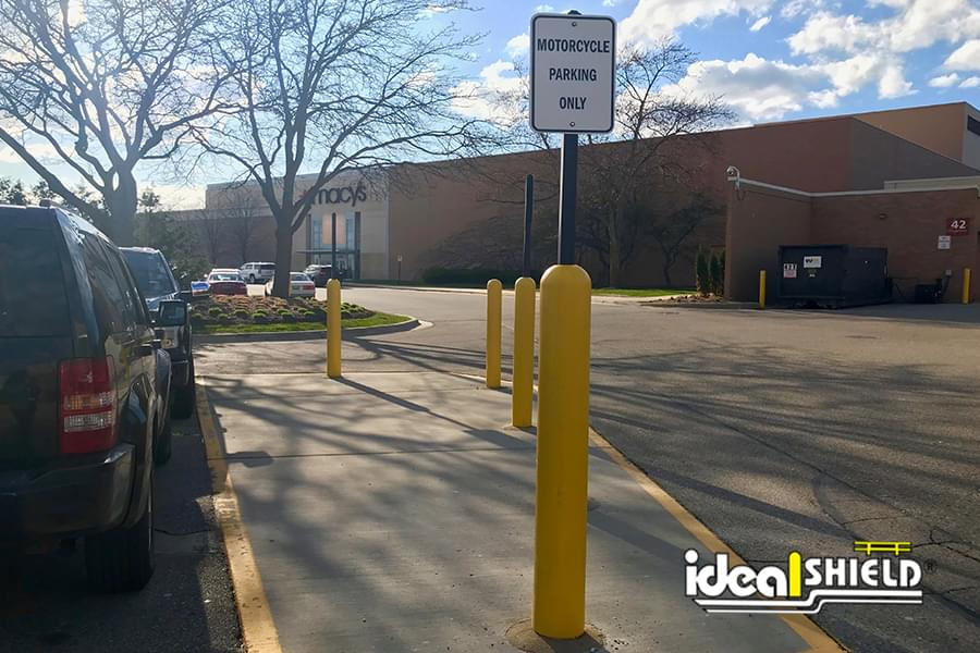 Ideal Shield's Yellow Bollard Sign Systems used for Motorcycle Parking Only Signs in Mall Parking Lot