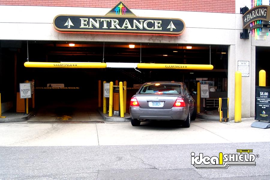 Parking Garage Entrances With Yellow Clearance Bars