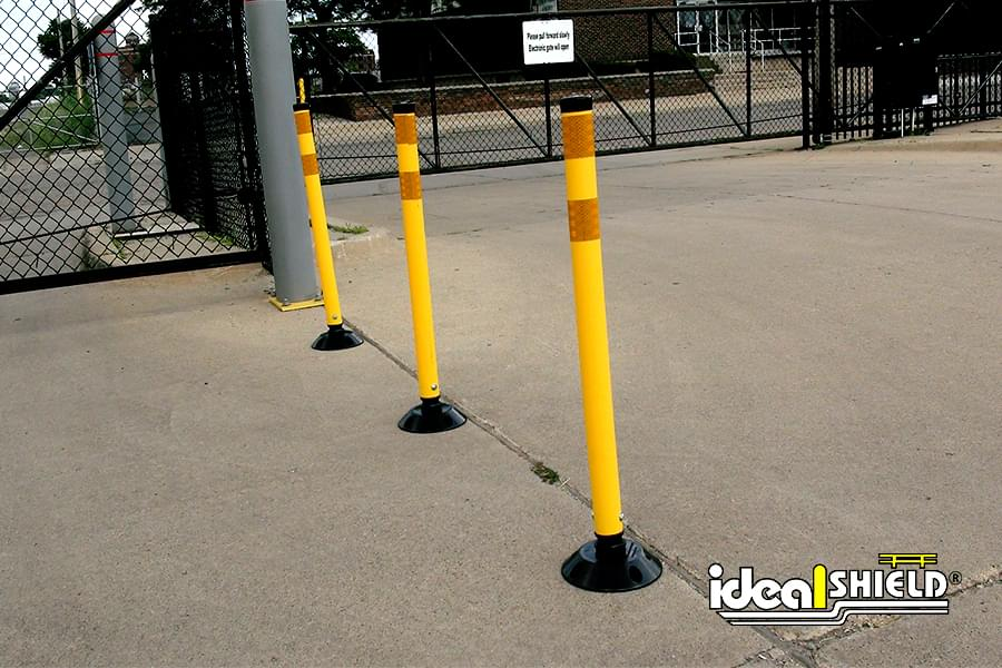 Parking Lot Traffic Directed By Delineator Posts with Stripes