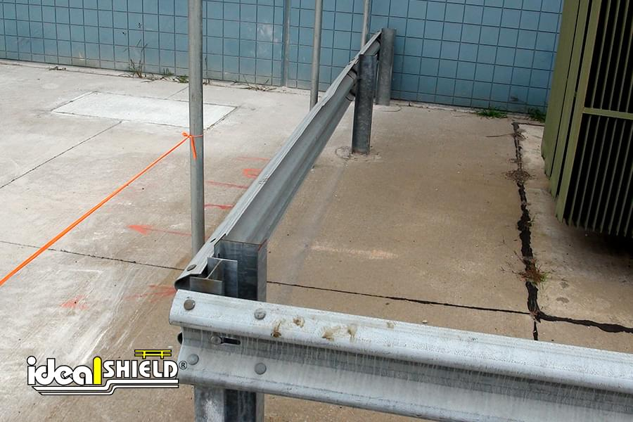 Highway Guardrail Protecting Warehouse Utilities