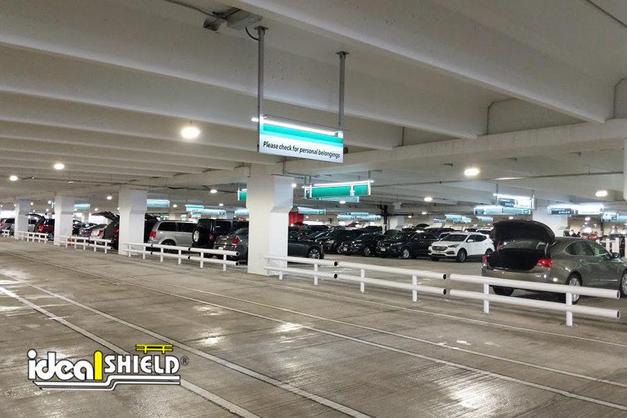 Ideal Shield's White Standard Two-Line Guardrail in a Parking Garage