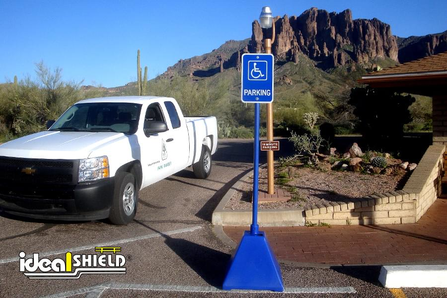 Ideal Shield's blue plastic Pyramid Sign Base used for handicap accessible parking