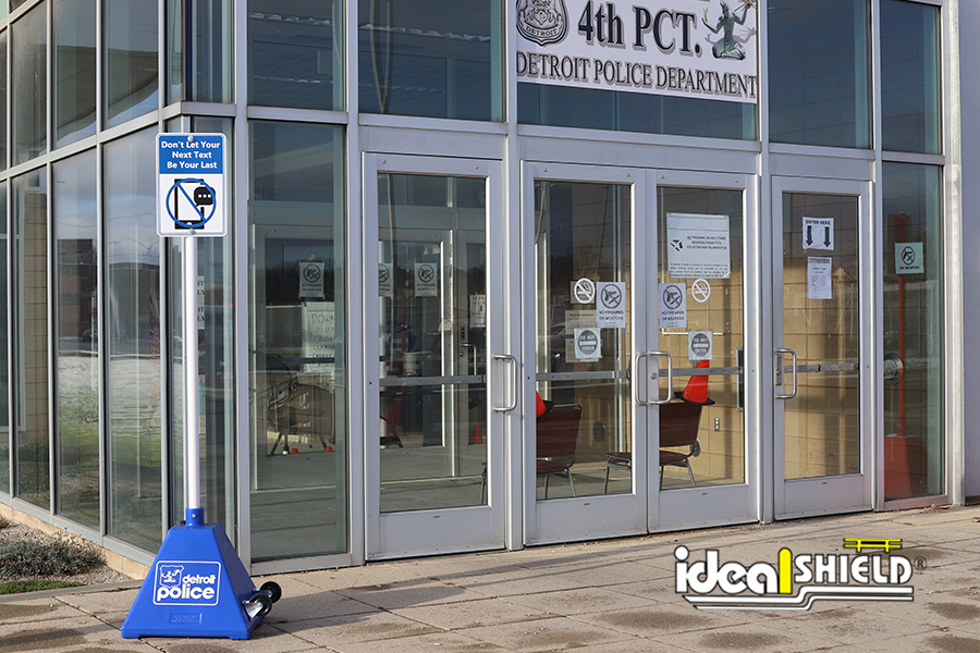 Ideal Shield's Portable Sign Base designed for the Detroit Police Department's Stop Distracted Driving campaign