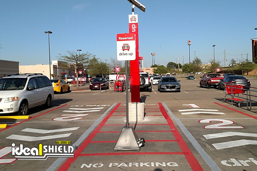 Ideal Shield's dark gray Portable Sign Bases designed for Target's mobile order pick up parking spots