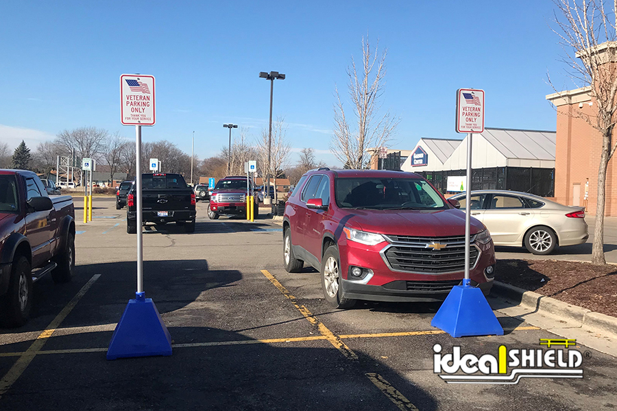 Ideal Shield's blue Pyramid Sign Bases designed for Veteran's parking at Lowe's