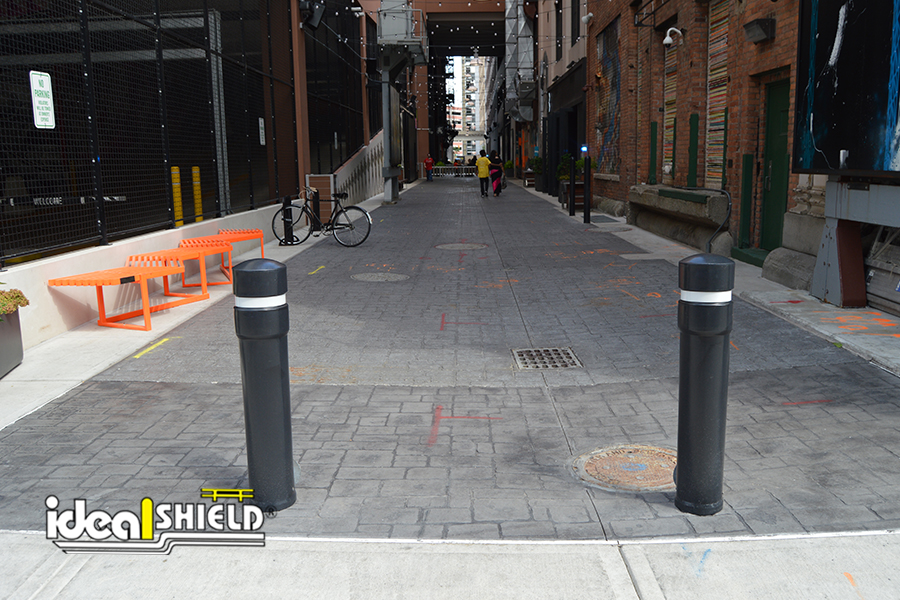 Ideal Shield's Removable Locking Bollards guarding an alleyway