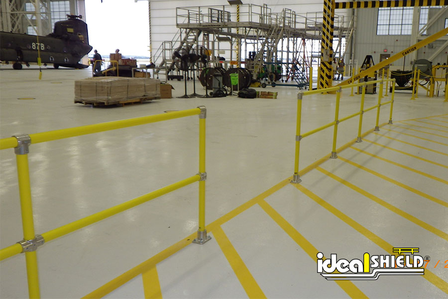 Ideal Shield's Steel Pipe & Plastic Handrail on a factory floor