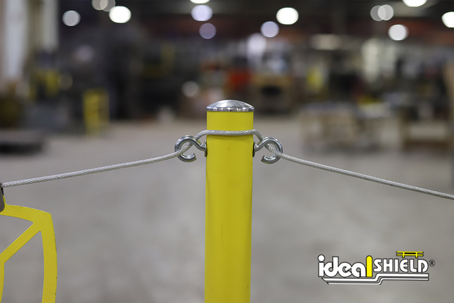 Close up of Ideal Shield's Warning Line System eye bolts with cable installation