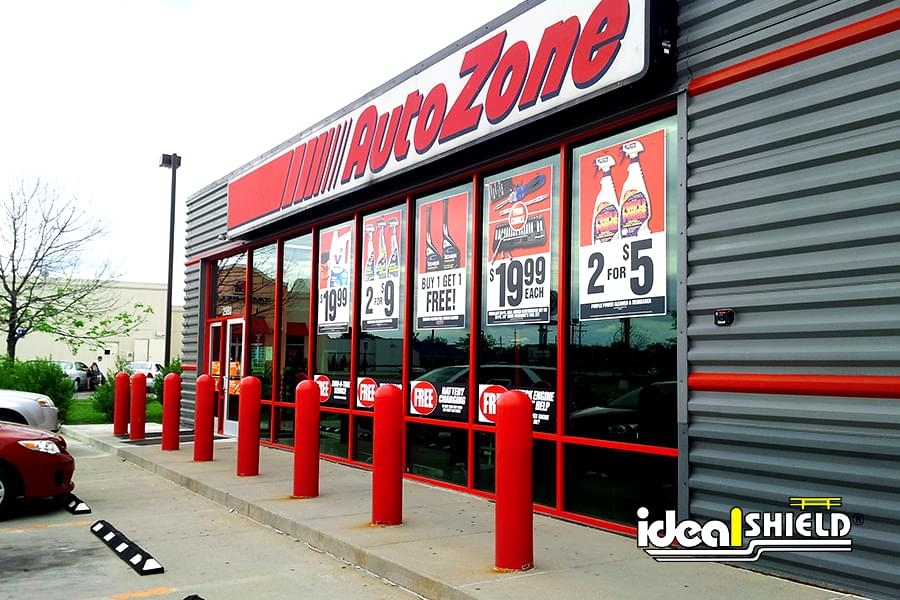 Ideal Shield's red bollard covers in front of AutoZone