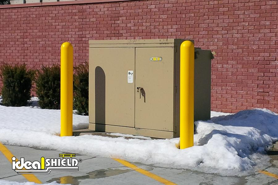 Ideal Shield's yellow plastic Bollard Covers guarding an electric box