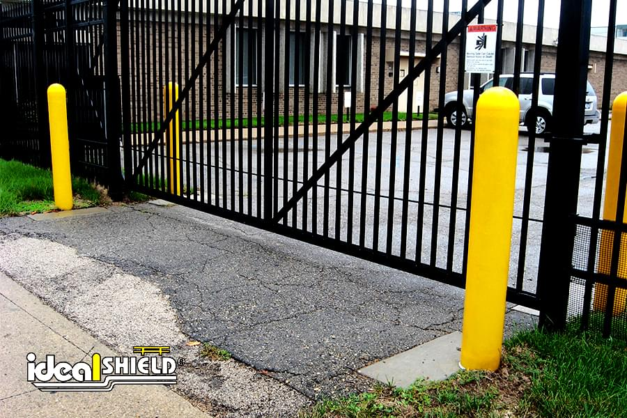 Ideal Shield's yellow dome top bollard covers protecting an entrance gate