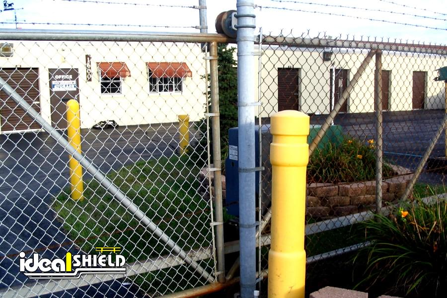 Ideal Shield's yellow architectural bollard covers at a storage facility