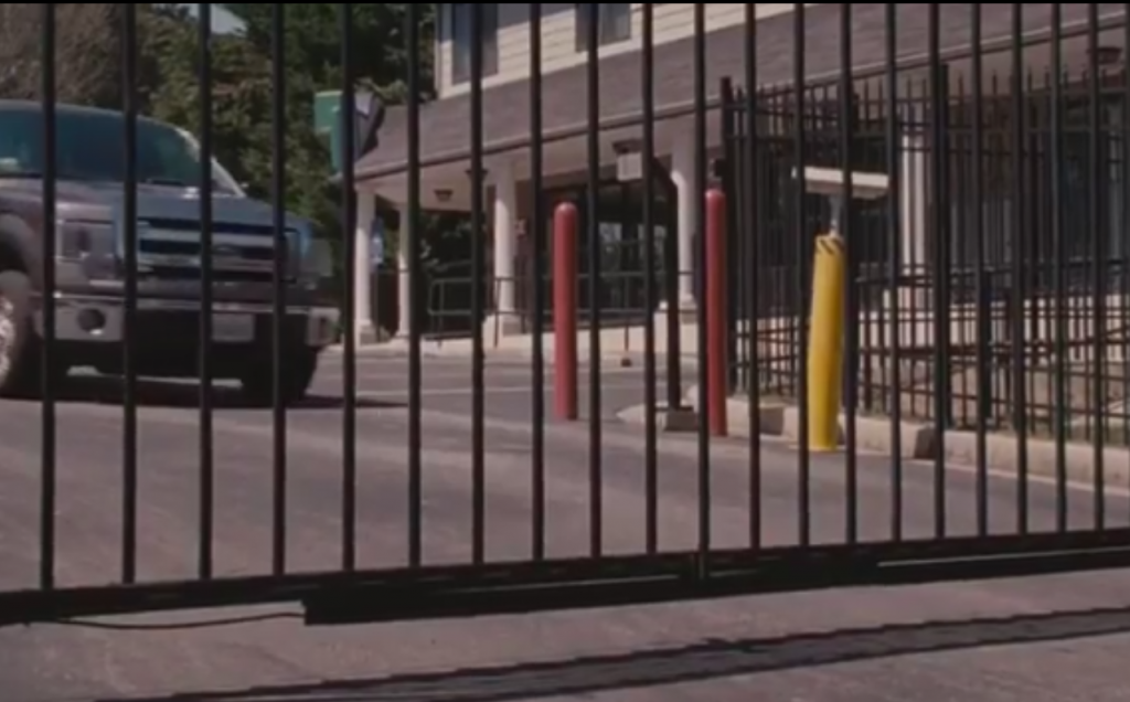 "Ideal Shield's red bollard covers at a storage unit in the movie ""The Accountant"""