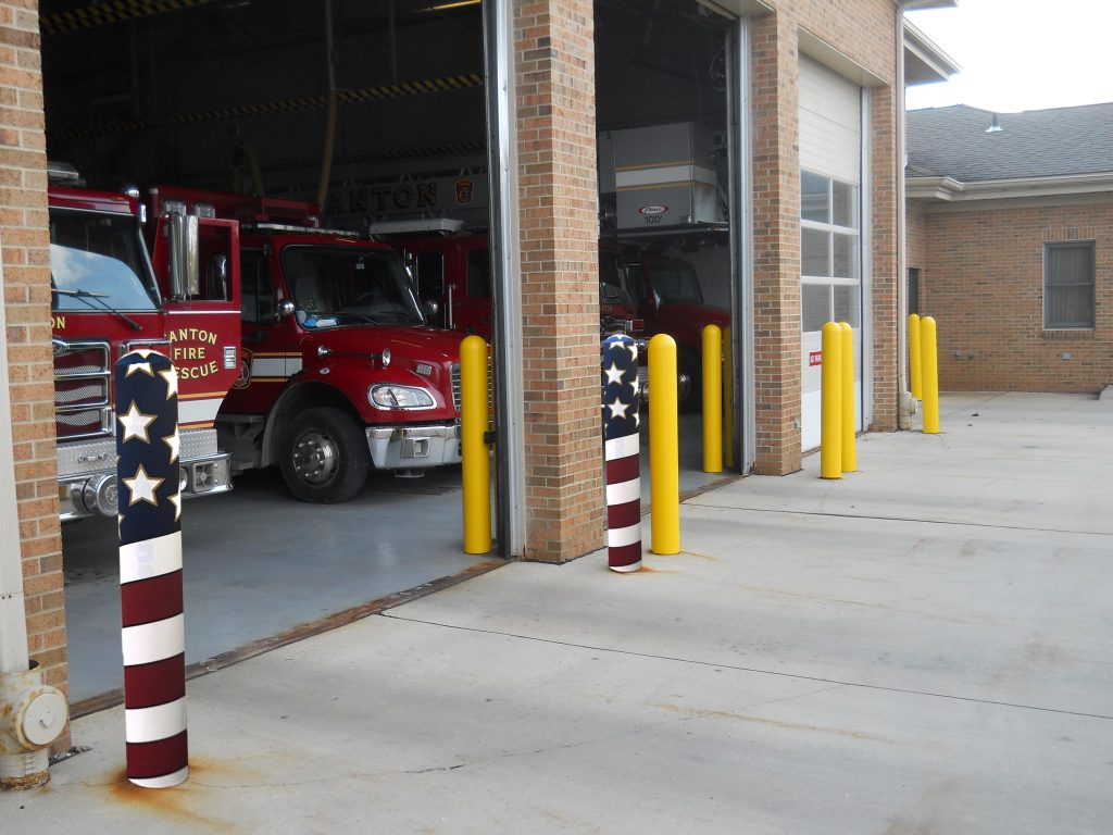Ideal Shield's Bollard Covers and American Flag Fabric Bollard Covers outside of a fire station