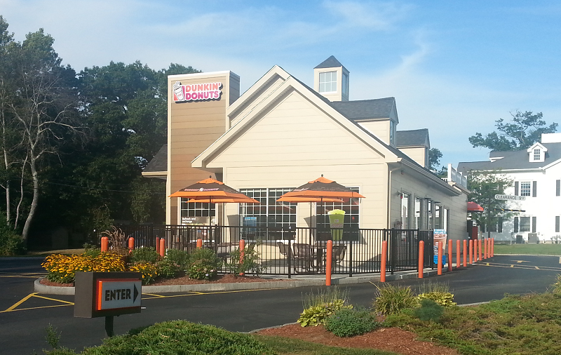 Ideal Shield's orange bollard covers at Dunkin' Donuts