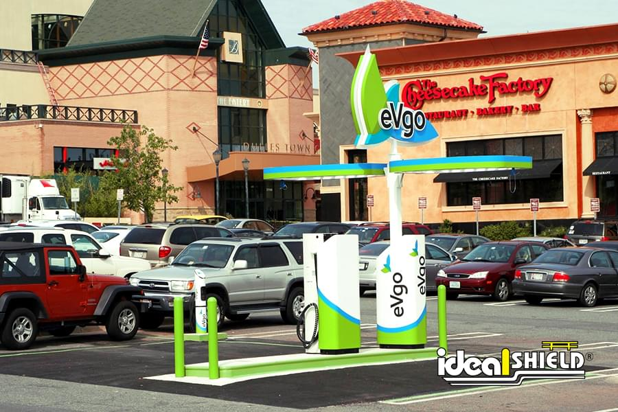 Ideal Shield's lime green bollard covers protecting an eVgo station