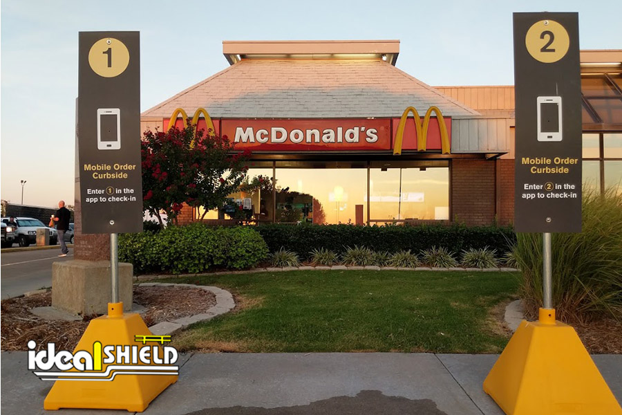 Ideal Shield's Pyramid Sign Bases are used by McDonalds for its Drive-Thru and Curbside Pickup parking