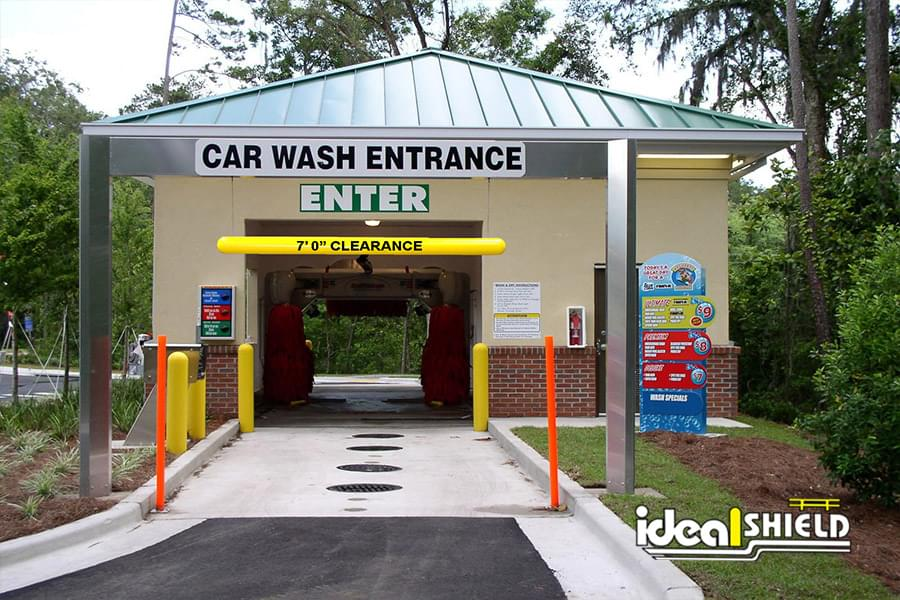 Ideal Shield's bollard covers and clearance bar at a car wash