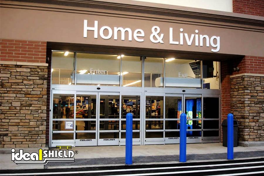 Ideal Shield's blue bollard covers guarding a Walmart storefront