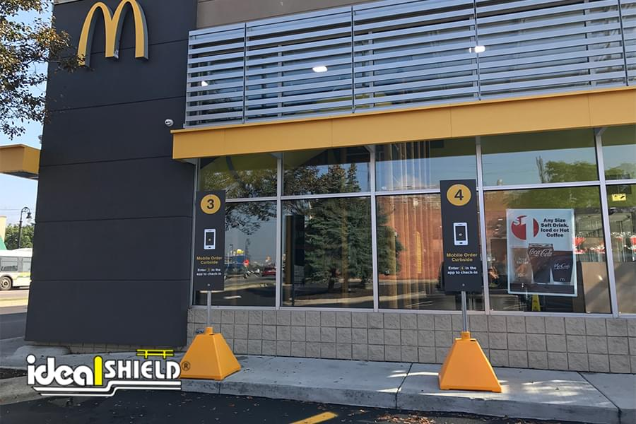 Ideal Shield's Dollar Gold Pyramid Sign Bases used for Mobile Ordering at McDonald's