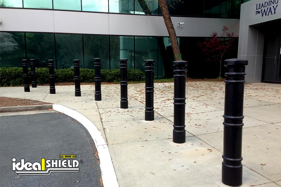 Ideal Shield's Black Metro Decorative Bollard Covers guarding a drop-off/entrance area.