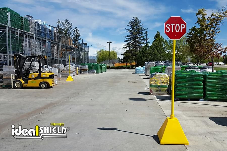 Ideal Shield's yellow plastic Pyramid Sign Base used as a stop sign at Lowe's