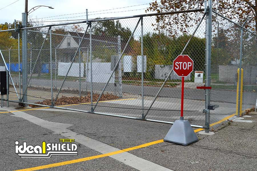 Ideal Shield's metallic silver plastic Pyramid Sign Base used as a stop sign