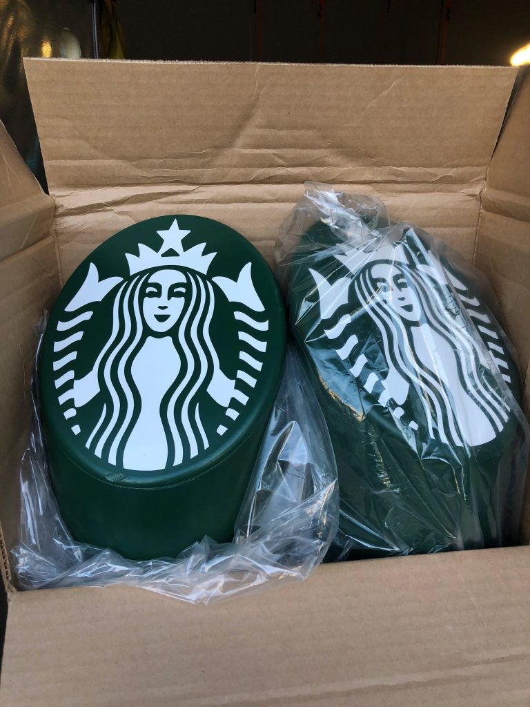 Ideal Shield's custom logos for Starbucks on the Skyline Decorative Bollard Covers