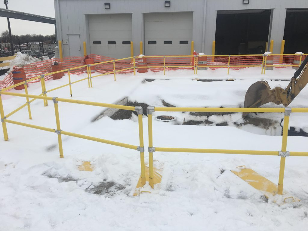 Ideal Shield's Fall Protection Railing guarding an excavation construction site.