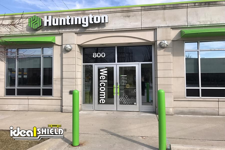 Lime green bollard covers were designed to match Huntington Bank's color scheme