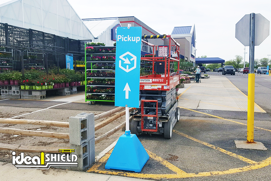 Custom Carolina blue sign bases with white posts for Lowe's mobile ordering services