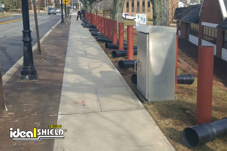 Ideal Shield's American-made steel pipe bollards being installed