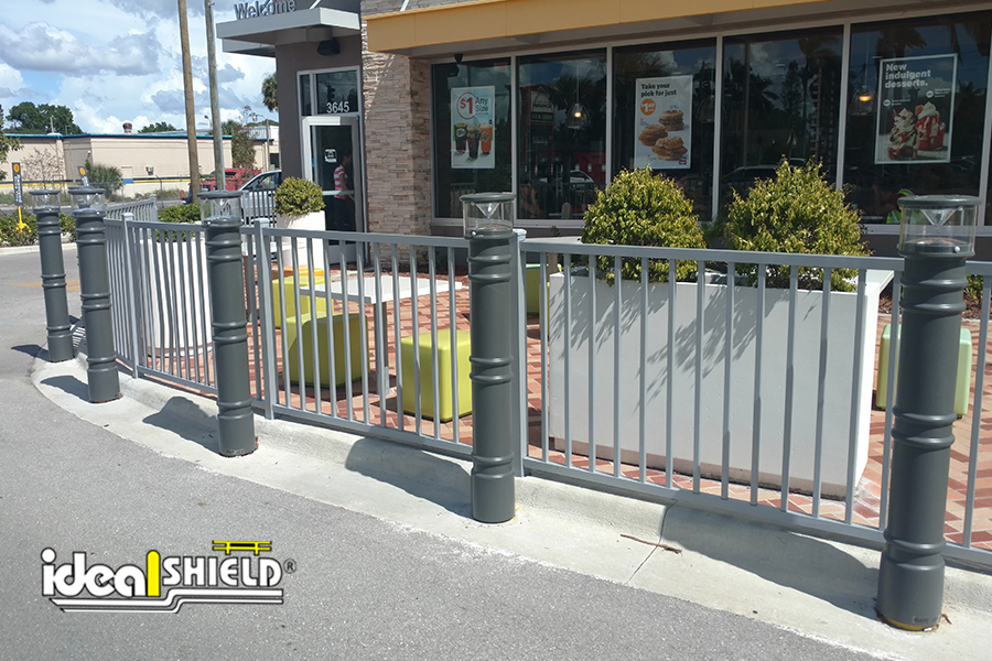 Ideal Shield's Lighted Bollard Covers guarding a patio at McDonald's