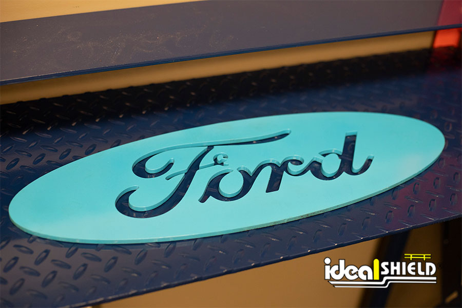 Custom cut metal art of the Ford Motor Company logo by Ideal Shield