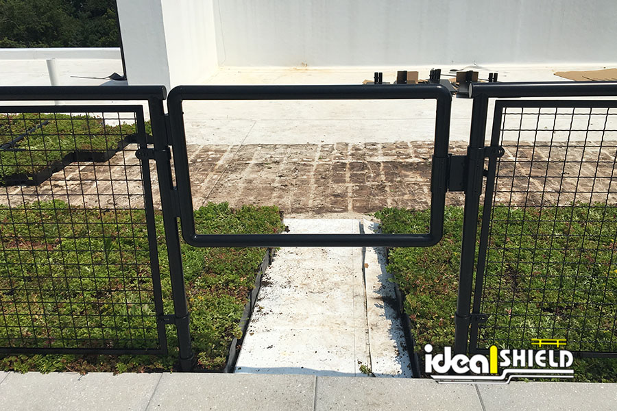 Ideal Shield's Aluminum Handrail with Roof Fall Protection Base Plates used for rooftop patio pathway