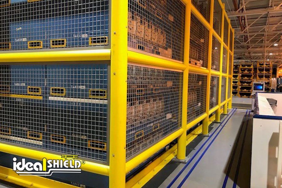 Ideal Shield's Safety Wall Guardrail with infill panels and kick plates designed to protect storage racks