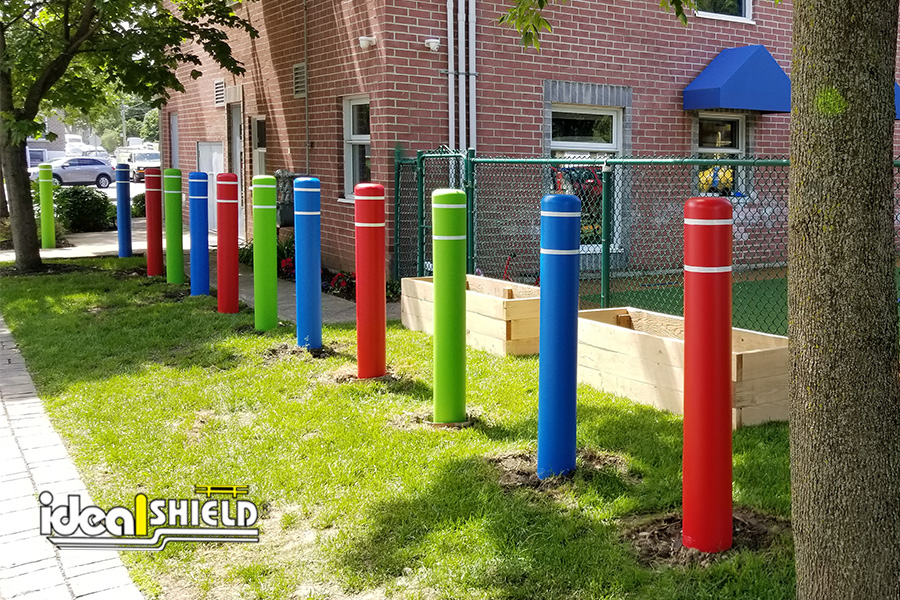 Ideal Shield's Flat Top Bollard Covers lining a playground
