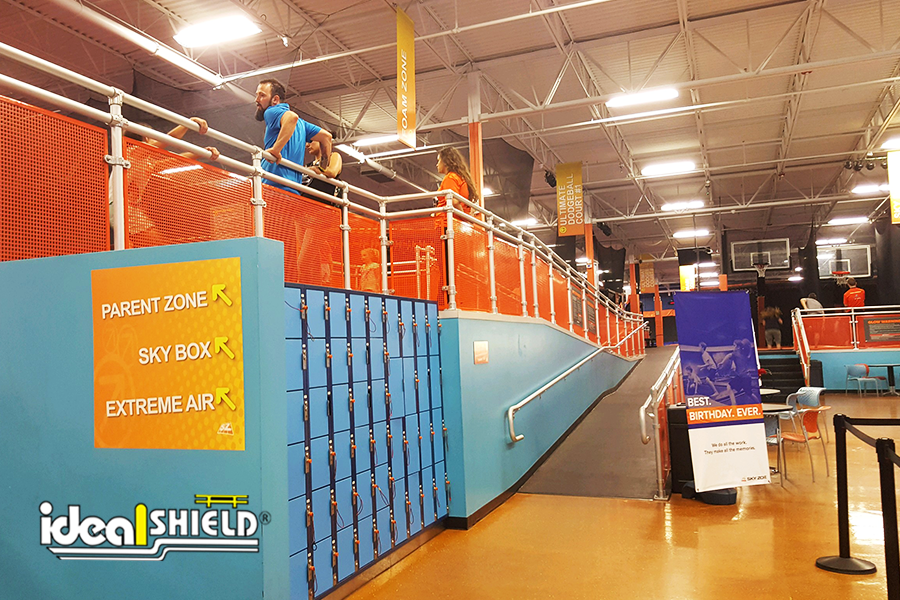 Ideal Shield's Aluminum Handrail with Orange Infill panels around SkyZone Trampoline Park