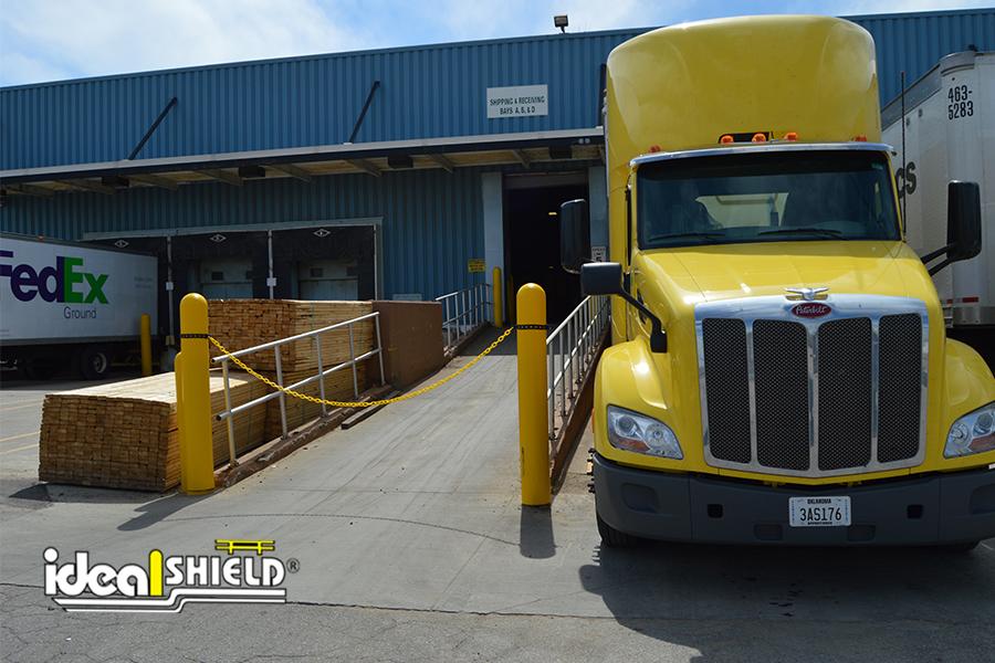 Ideal Shield's Bollard Chain Kit blocking off a facility entrance ramp