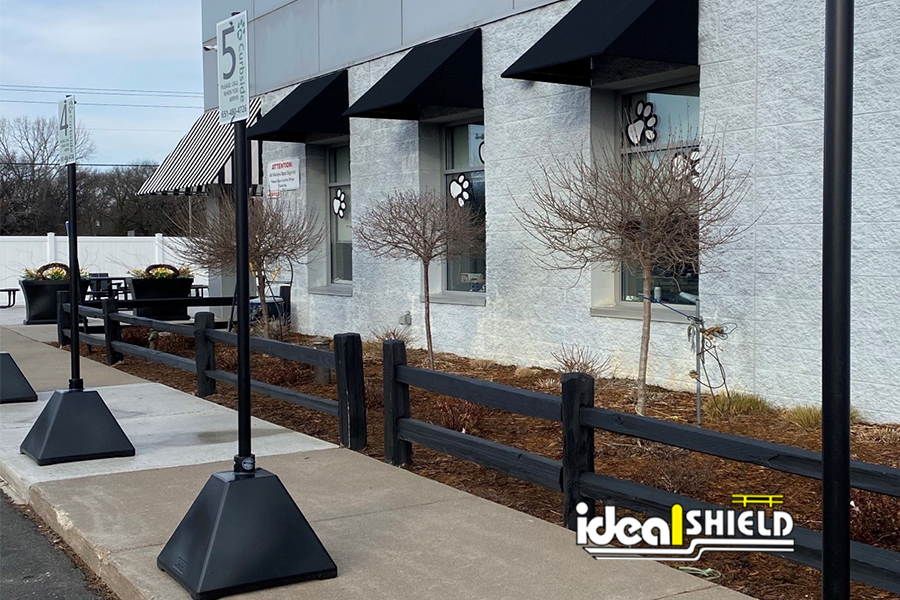 Ideal Shield's Black Pyramid Sign Bases used for curbside pickup at a pet store