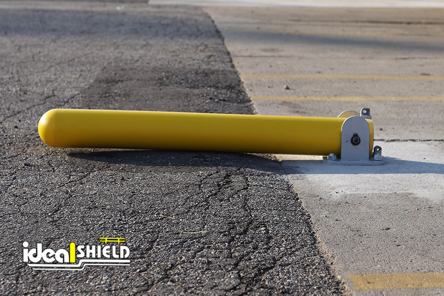 Ideal Shield's Collapsible Locking Bollard laid down for vehicle entrance