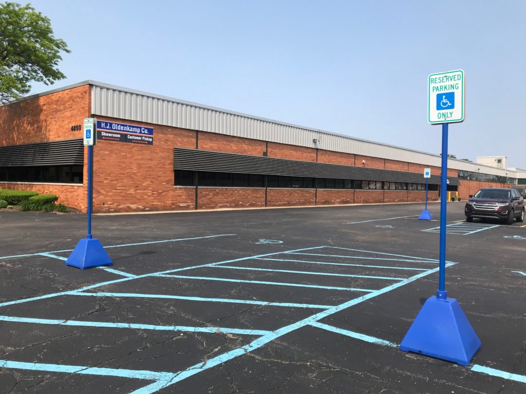 Ideal Shield's Blue Pyramid Sign Bases used for Handicap Accessible Parking