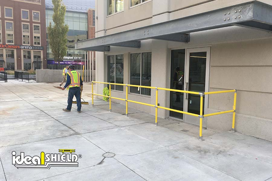 Ideal Shield's Steel Pipe & Plastic Handrail system used for a building entrance guide